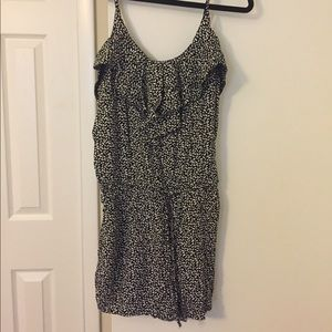Black and white polka dot romper with tie-waist